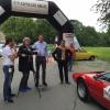 Das Team des Lamborgini Urraco wird interviewt. Sponsor Matthias Weber ist Copilot von bernhard Heudorf und erzählt über seine Business-Marathon Schuhe